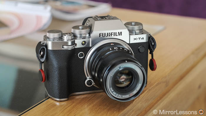 Fujifilm X-T4 with 50mm F2 attached on a wooden and glass short table