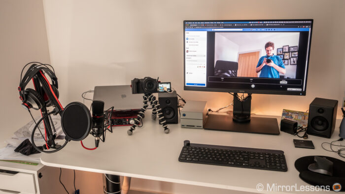 desk with laptop, screen and camera connected