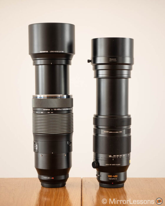 olympus 100-400mm vs panasonic 100-400mm side by side with hoods and zoom extended (including built-in hood)