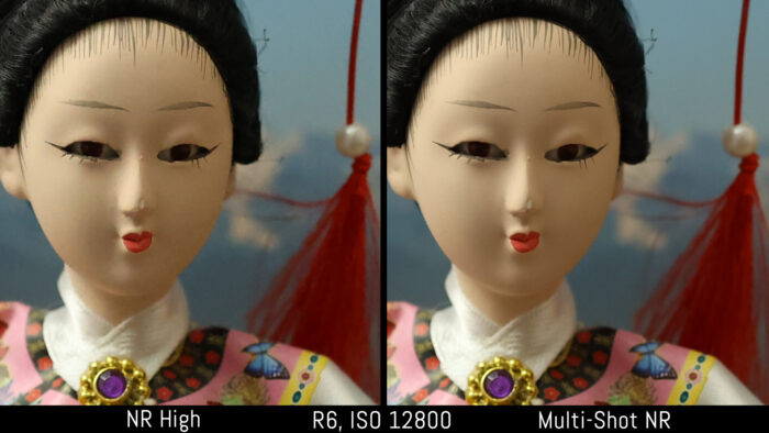crop of the japanese doll out of camera JPEG image to show the difference in noise at 12800 ISO with noise reduction set to High and Multi-Shot NR for the Canon