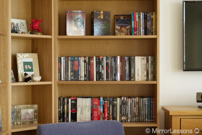 bookshelf with dvd boxes