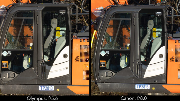 side by side image showing the close-up of an excavator, on the left taken with the Olympus 150-400mm Pro at 400mm and f5.6, on the right with the Canon 800mm at f8