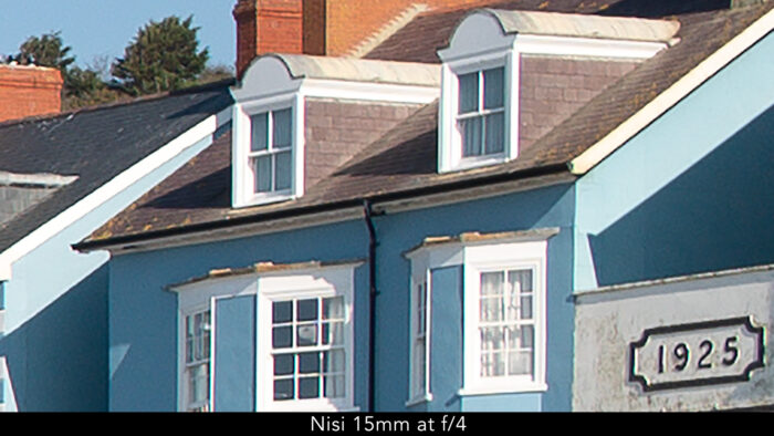 crop of the previous seaside image, showing details of a building with chromatic aberration on the vertical edges of windows