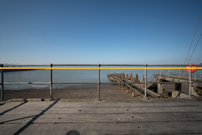 railing in front of the sea to showcase distortion