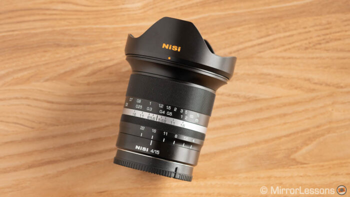 Nisi 15mm with hood attached on a wooden surface