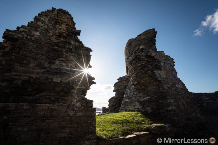 castle ruins in backlight with visible sunstar flare