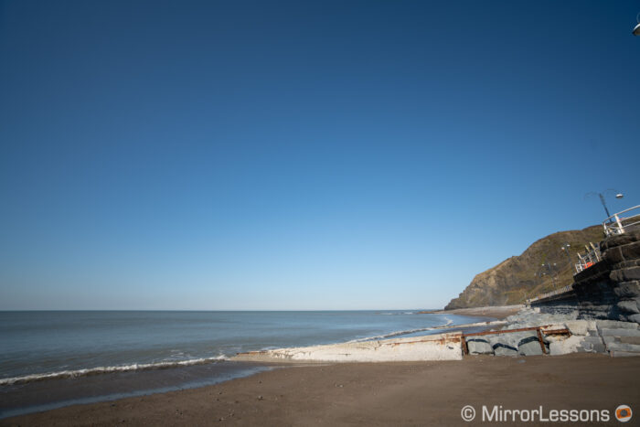 beach and blue sky showcasing vignetting at f4