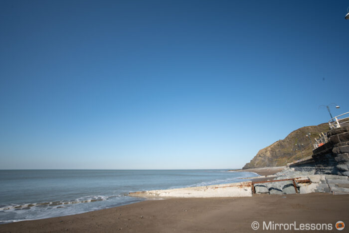 beach and blue sky showcasing vignetting at f11