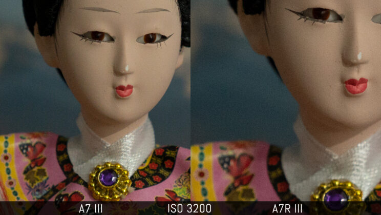 side by side crop of the doll image image showing the quality of the A7 III and A7R III at ISO 3200
