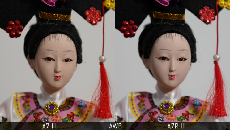 side by side close-up of a Japanese doll taken with the A7 III and A7R III to show the result with Auto White Balance