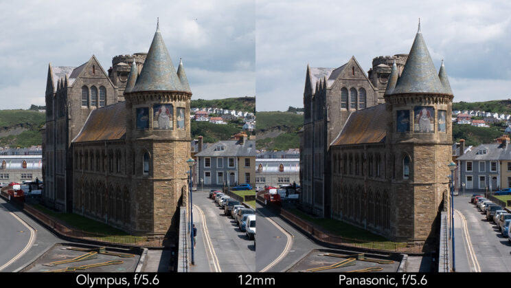 side by side enlargement of the centre of the image (where the castle is) showcasing the difference in sharpness between the two lenses set at 12mm and f5.6
