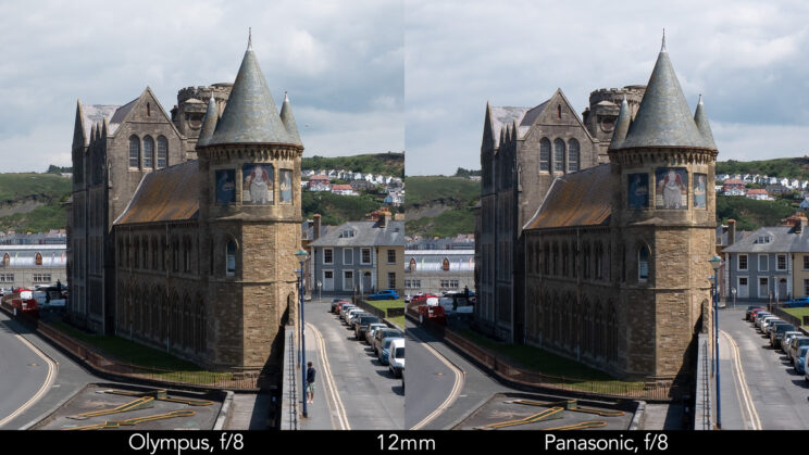 side by side enlargement of the centre of the image (where the castle is) showcasing the difference in sharpness between the two lenses set at 12mm and f8