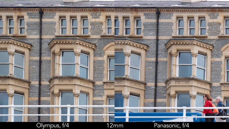 side by side enlargement of top left corner (details of the buildings) showcasing the quality at 12mm and f4 for the two lenses