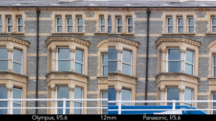 side by side enlargement of top left corner (details of the buildings) showcasing the quality at 12mm and f5.6 for the two lenses