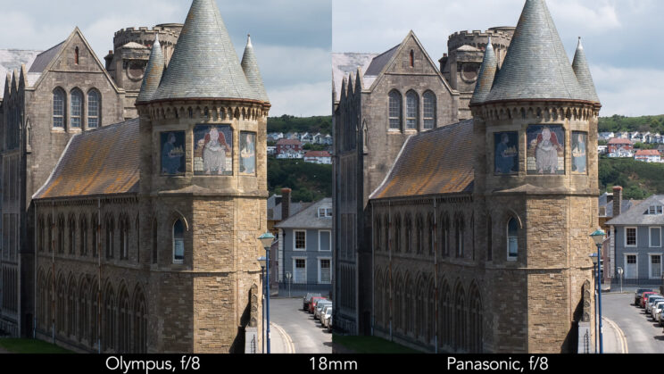 side by side enlargement of the centre of the image (where the castle is) showcasing the difference in sharpness between the two lenses set at 18mm and f8