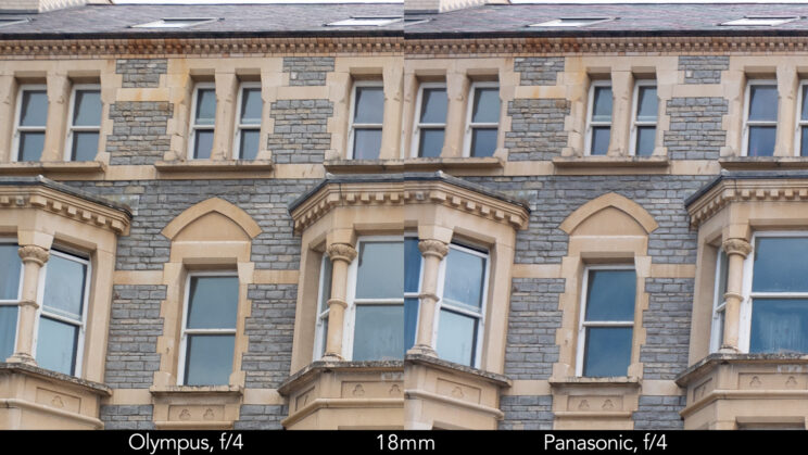 side by side enlargement of top left corner (details of the buildings) showcasing the quality at 18mm and f4 for the two lenses