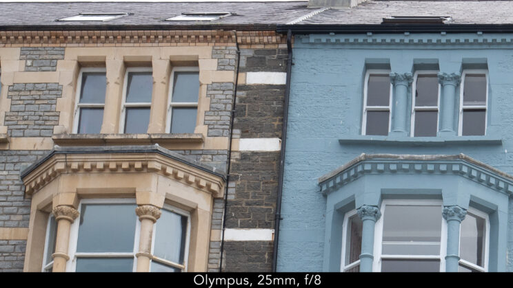 enlargement of top left corner (details of the buildings) showcasing the quality at 25mm and f8 for the Olympus lens