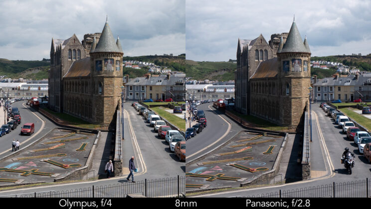 side by side enlargement of the centre of the image (where the castle is) showcasing the difference in sharpness between the two lenses set at 8mm and f4 for the Olympus, f2.8 for the Panasonic lens