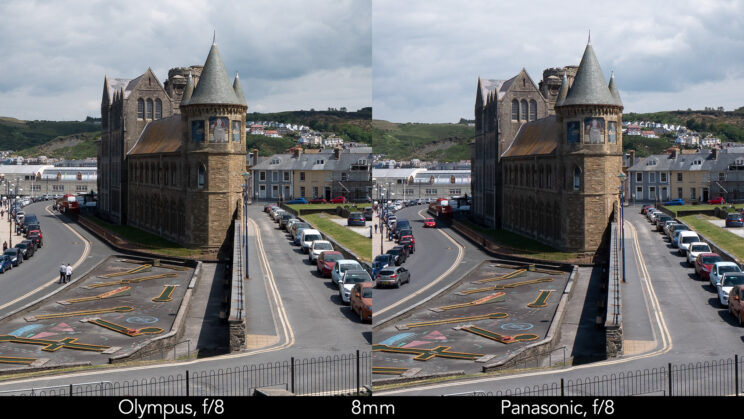 side by side enlargement of the centre of the image (where the castle is) showcasing the difference in sharpness between the two lenses set at 8mm and f8