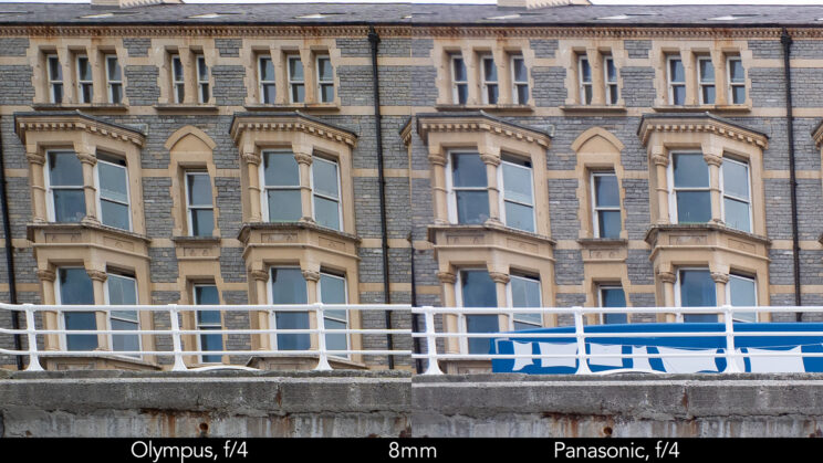 side by side enlargement of top left corner (details of the buildings) showcasing the quality at 8mm and f4 for the two lenses