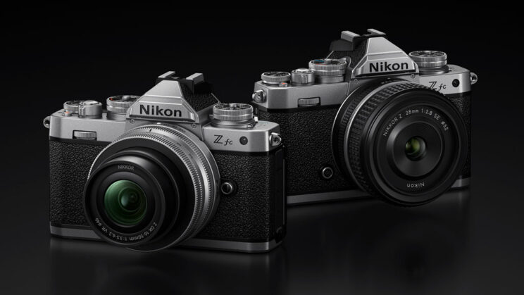two nikon Z fc cameras with different lenses attached, side by side on black background