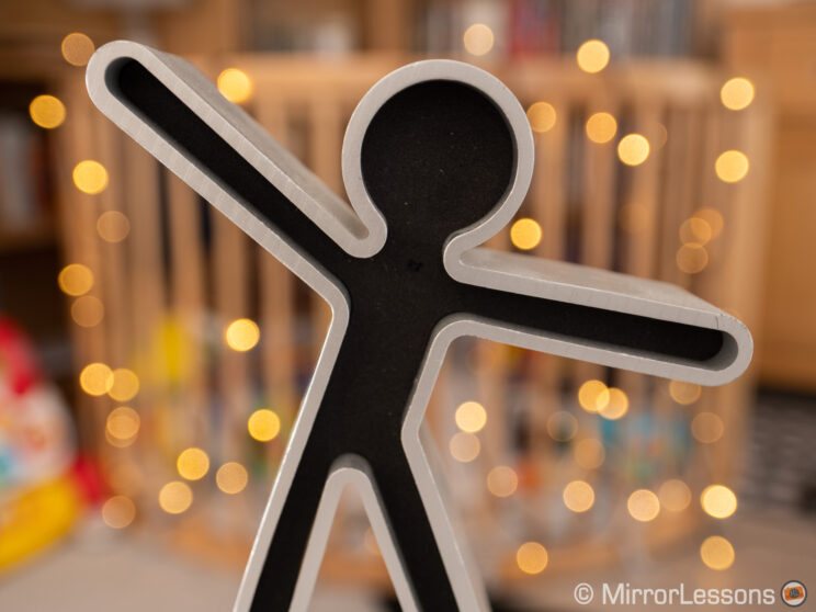 close-up on a small figure with bokeh balls on the background