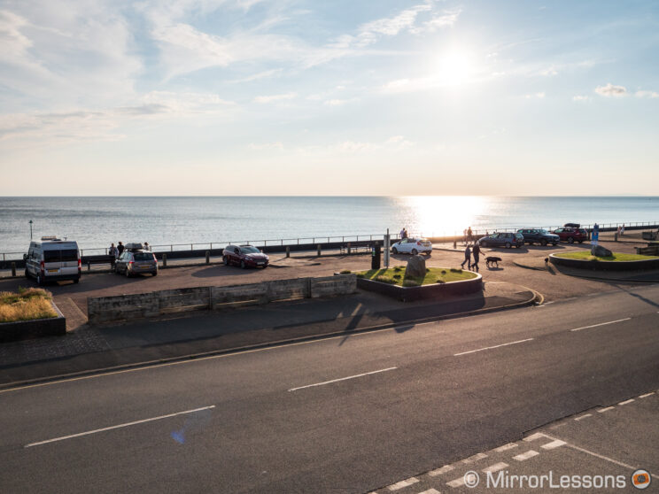 seafront with sea in the background, promenade and road in the foreground, near sunset time
