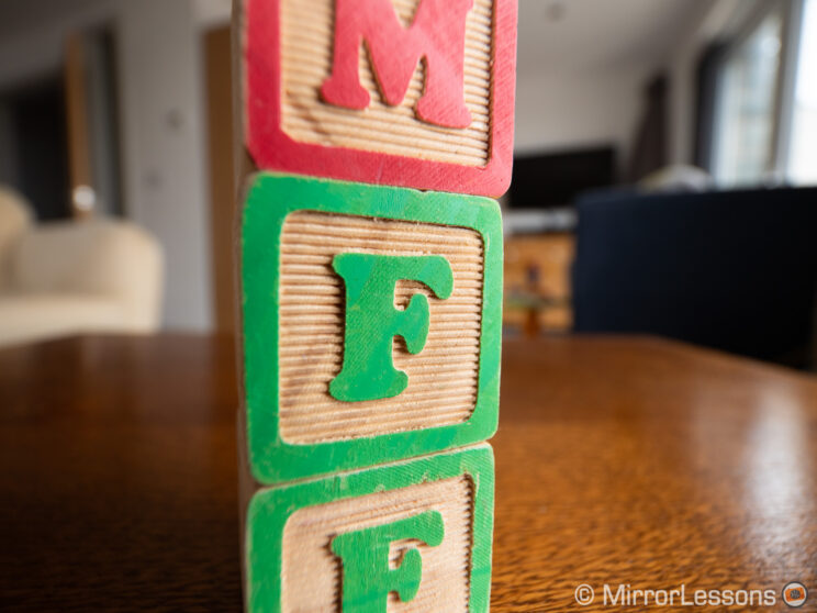 close-up on three piled toy cubes