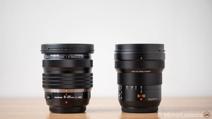 Olympus 8-25mm Pro and Panasonic 8-18mm side by side, without lens hood