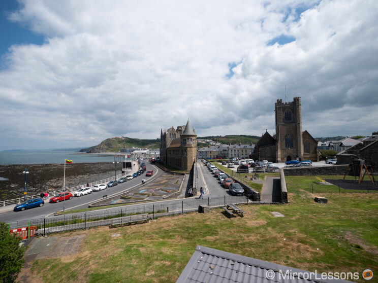 view of a seaside town with a castle in the middle