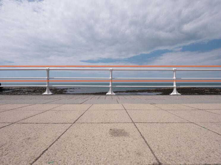 promenade on the seafront with a white handrail