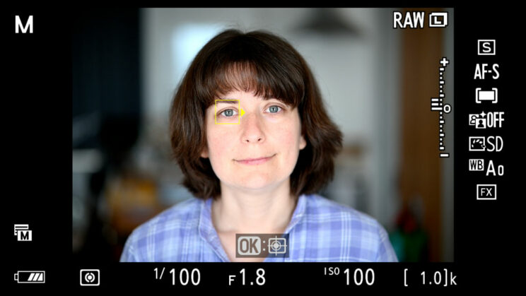 screenshot of the Nikon Z6 live view, showing Eye AF at works on a woman's face