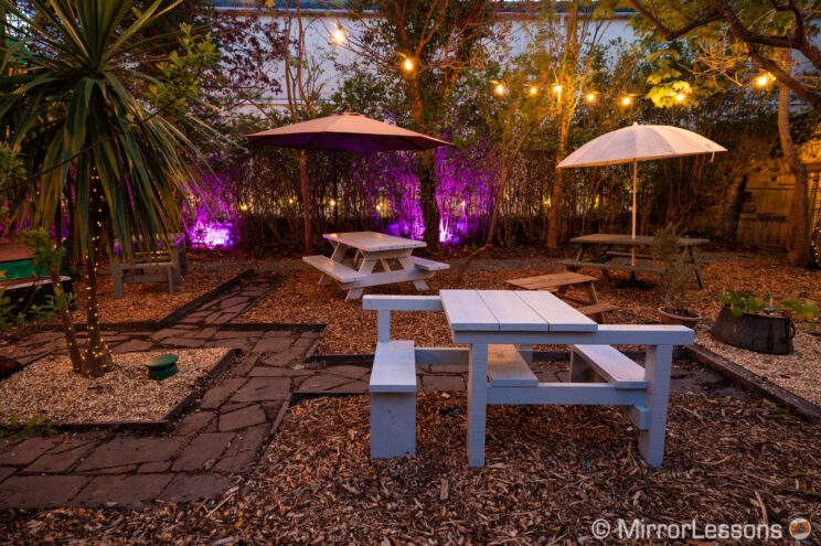 outdoor beer garden at night with lights on