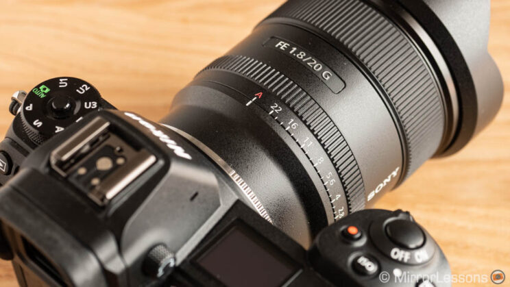 close-up of the Sony 20mm F1.8 G attached to the adapter and the Nikon Z6, and showing the aperture ring in the A position
