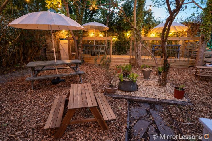 outdoor beer garden in the evening with lights on