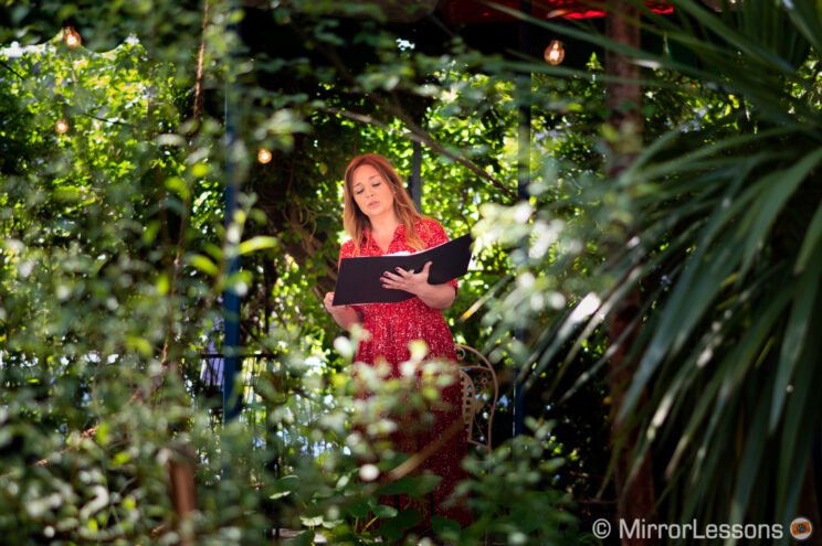 woman opera singer performing outdoor in a garden