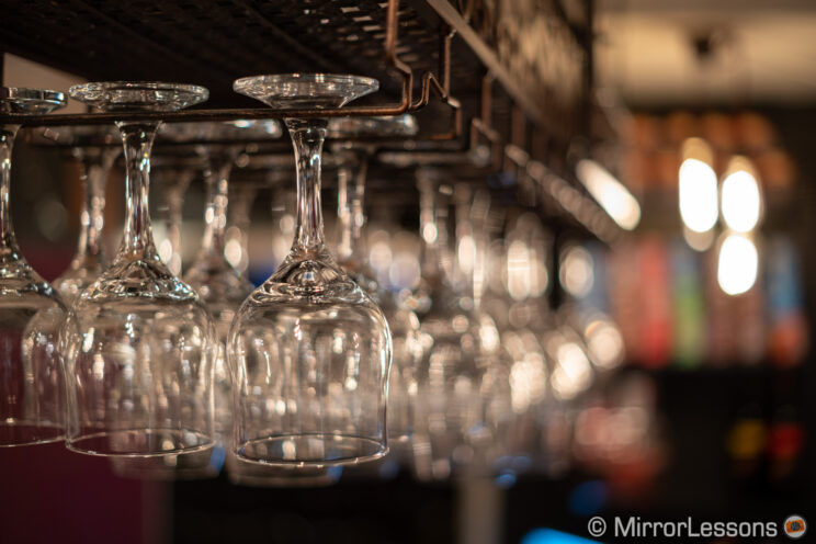 wine glasses hanging in a bar