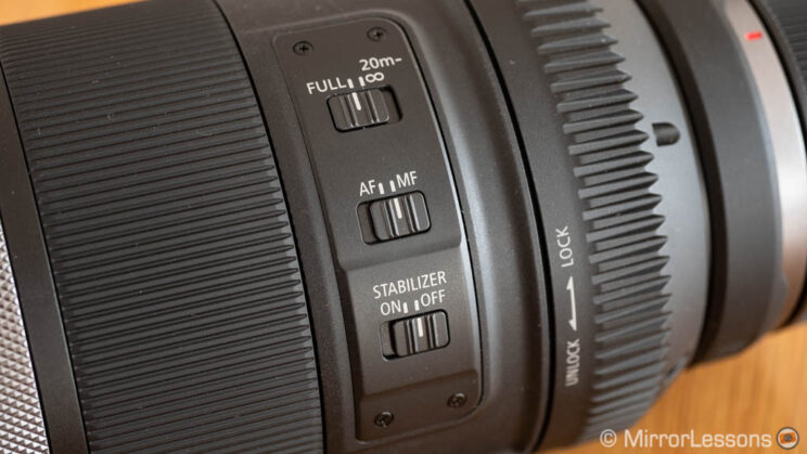 close-up on the three switches of the Canon 600mm F11