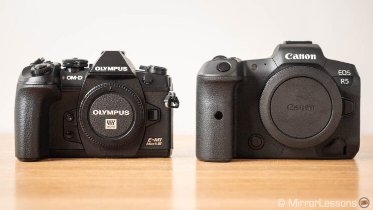 Olympus OM-D E-M1 III next to the Canon Eos R5, front view