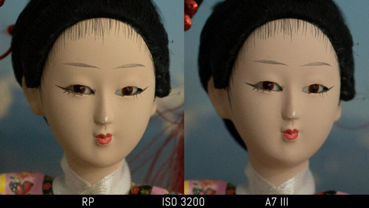 side by side image of a Japanese doll taken with the Canon RP and Sony A7 III, showing the difference in image quality and noise at ISO 3200