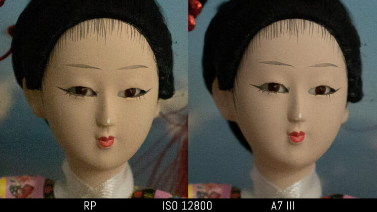 side by side image of a Japanese doll taken with the Canon RP and Sony A7 III, showing the difference in image quality and noise at ISO 12800
