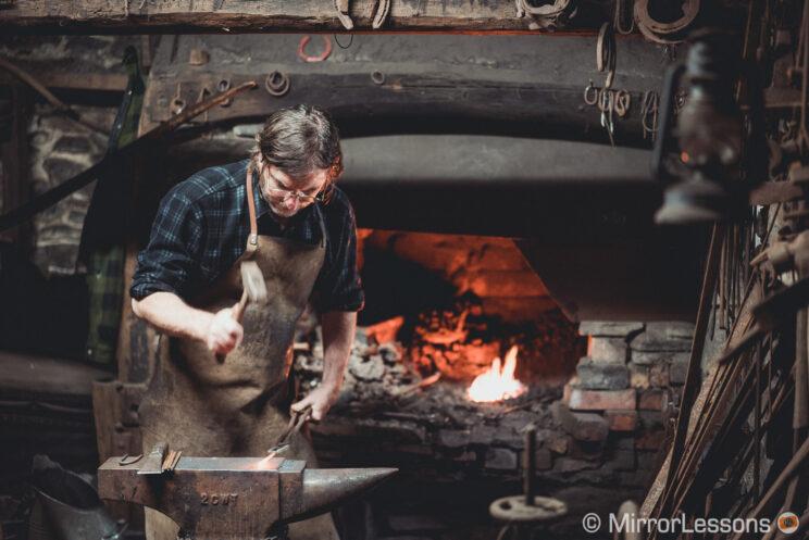 blacksmith working in his workshop